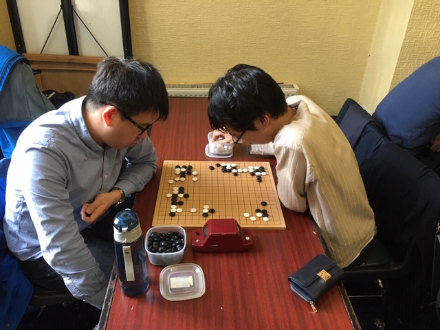 The decisive third round game between Yishen Wang and Tunyang Xie